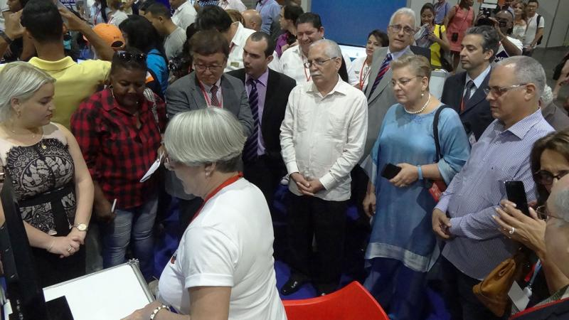 The opening included a tour of the fair by the presidency, which started at UCI exhibition booth