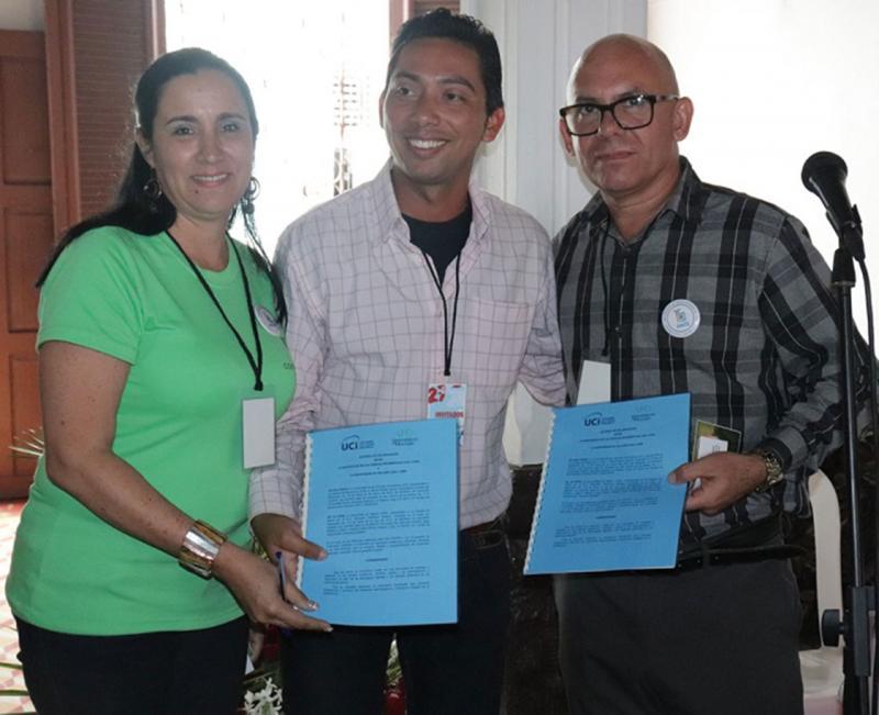 La firma del convenio entre la UHo y la UCI permitirá el intercambio editorial entre Ediciones Futuro y Conciencia Ediciones. Foto: Cortesía de la Dircom de la UHo