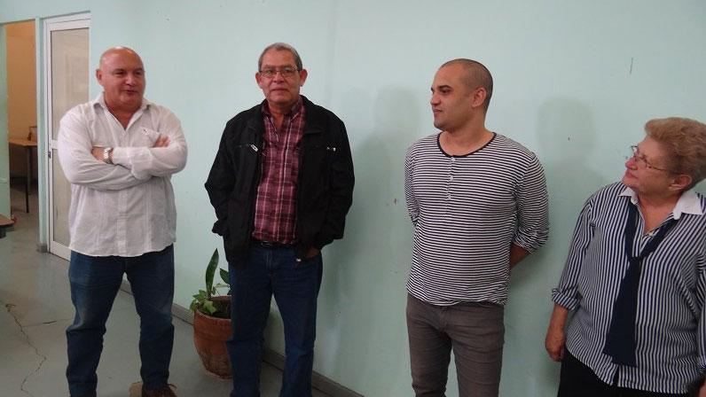 El rector del ISA, Alexis Seijo García (a la izquierda), dio la bienvenida a los trabajadores de Extensión Universitaria de la UCI, al igual que el vicedecano de Extensión Universitaria, Michel Cruz Gómez y su asesora, Luisa García Miranda (a la derecha).