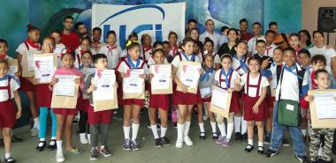 "In the award ceremony of the children's competition ""Aportando a la Revolución"" (My contribution to the Revolution) , children and teachers of the project ""Conectados al futuro"" (Connected to the future) and also from the José Martí Honoring Room, of School 1 at UCI."